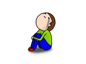 体操座りで泣く男の子